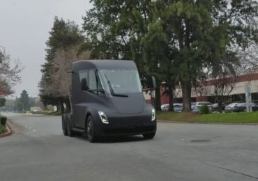 Prototype Tesla's electric truck drives around US suburb